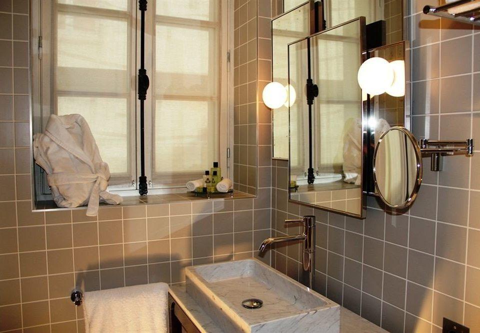 bathroom property home plumbing fixture sink flooring toilet tile Suite tiled