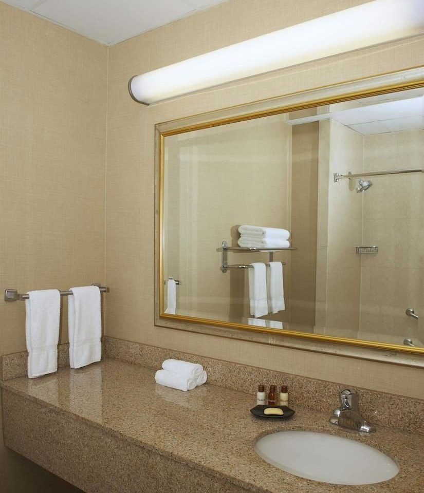 bathroom sink mirror property Suite towel flooring toilet plumbing fixture vanity rack tan