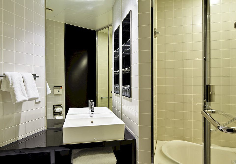 bathroom toilet sink plumbing fixture tile public toilet flooring Suite public tiled