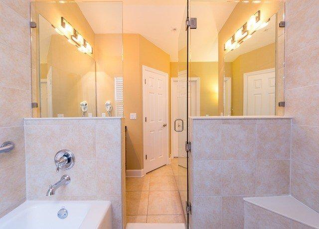 bathroom property toilet sink Suite plumbing fixture flooring