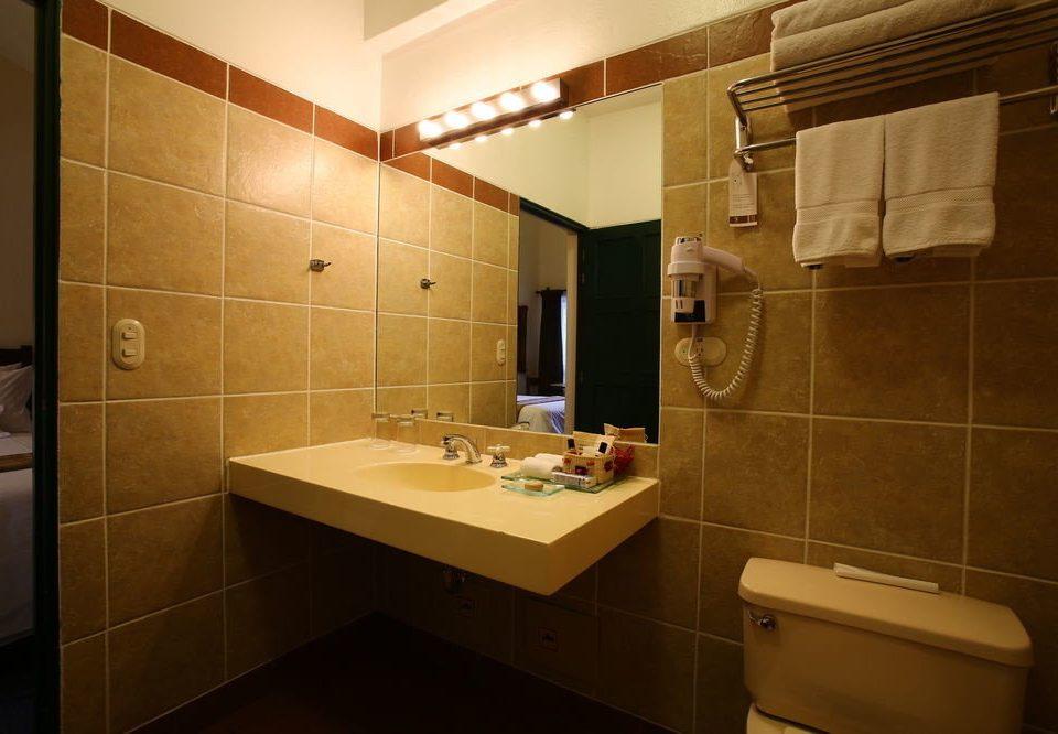 bathroom sink mirror property toilet light home plumbing fixture Suite tile tiled