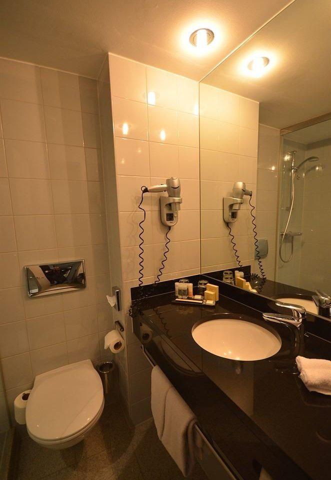 bathroom toilet sink property home lighting Suite