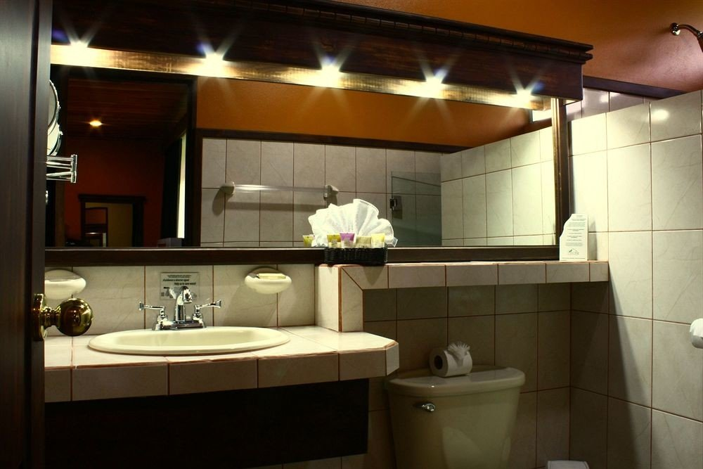 bathroom mirror sink property home lighting Suite