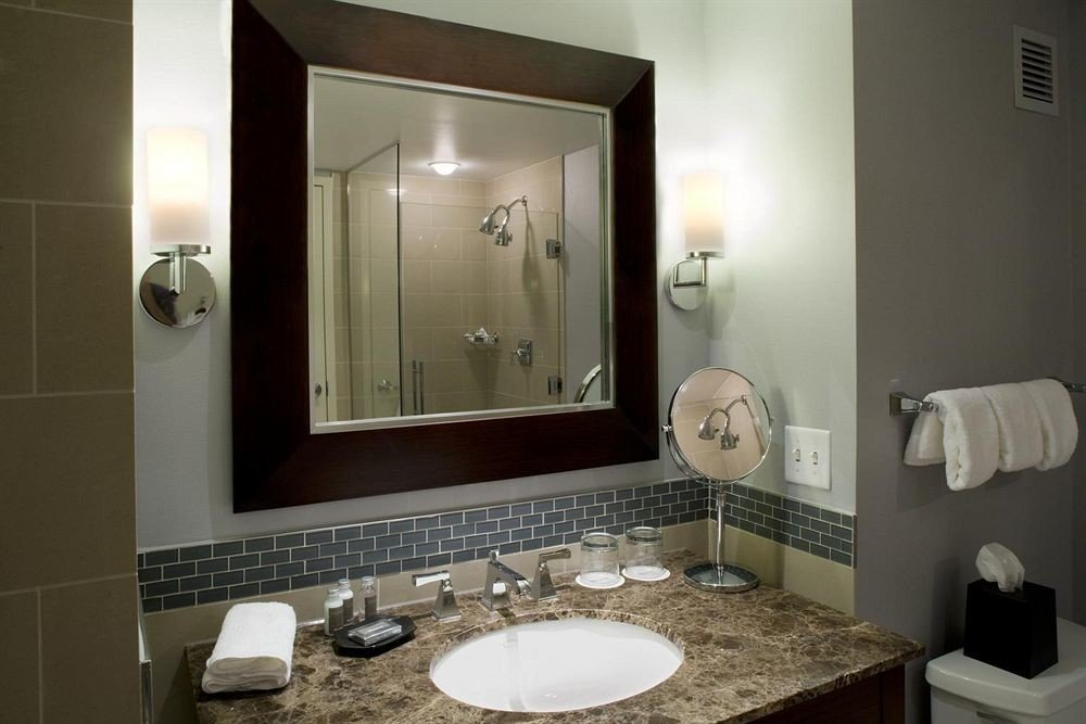 bathroom mirror sink property home towel lighting vanity Suite plumbing fixture tile