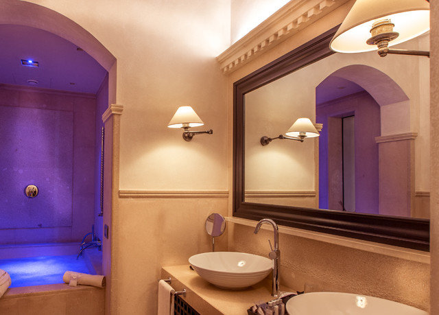 bathroom property swimming pool sink Suite home lighting