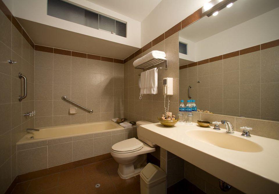 bathroom sink mirror property home toilet Suite long