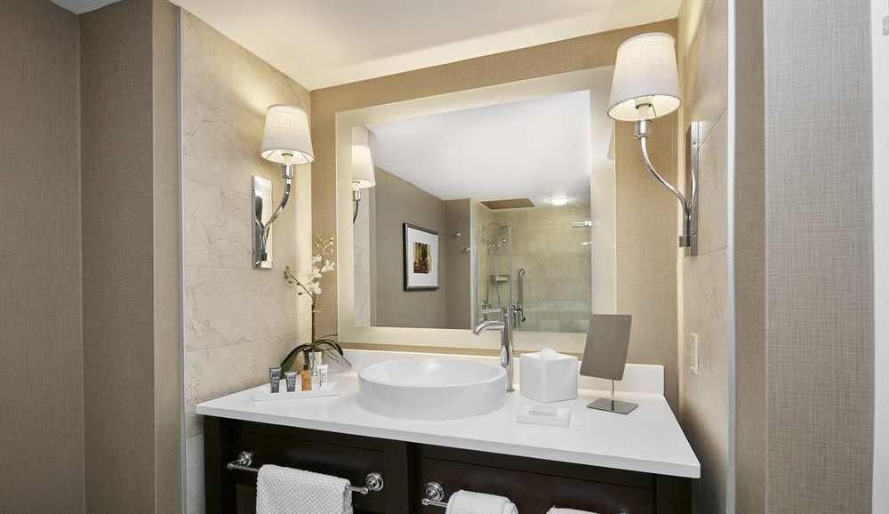 bathroom mirror sink property home toilet Suite plumbing fixture tan