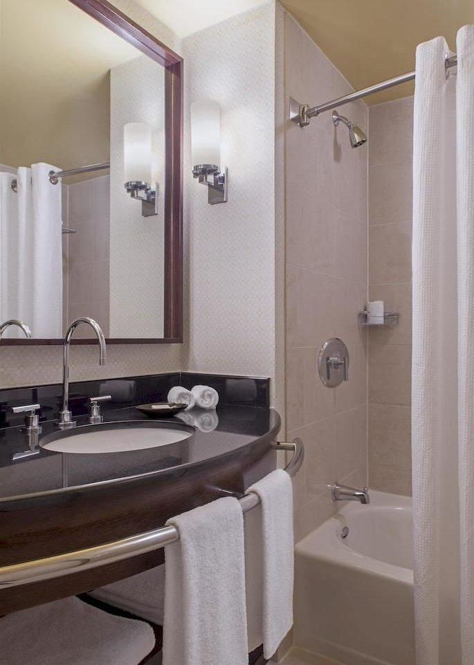 bathroom sink mirror property Suite home plumbing fixture towel rack tan