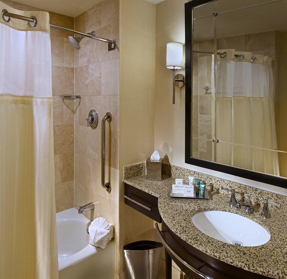 bathroom sink property mirror toilet home Suite plumbing fixture tan tile