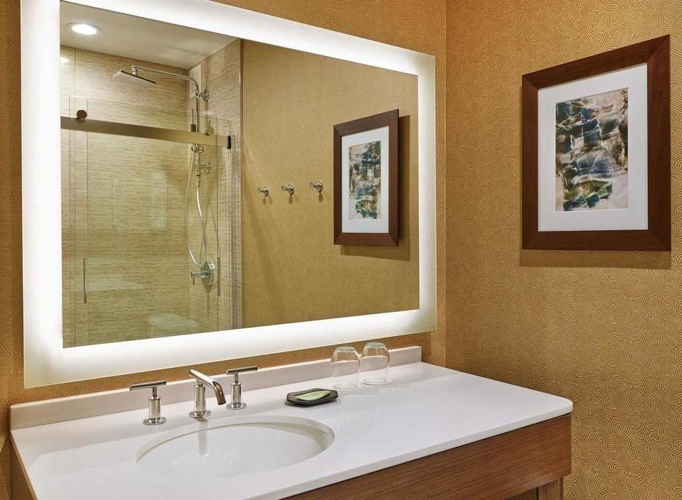 bathroom sink mirror property home plumbing fixture Suite tan