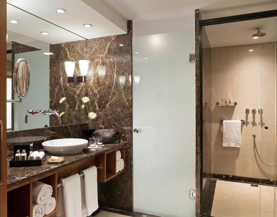 bathroom mirror property sink home Suite plumbing fixture