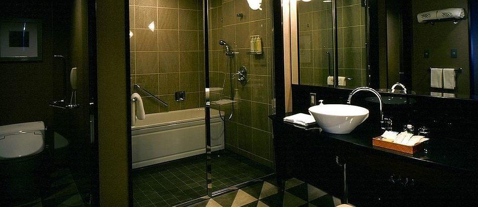 bathroom sink property mirror home plumbing fixture public public toilet toilet Suite tile tiled