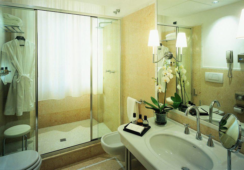 bathroom sink mirror property toilet home Suite plumbing fixture rack