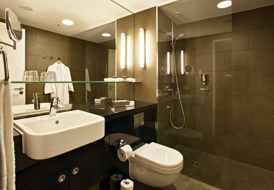 bathroom sink mirror property toilet home plumbing fixture Suite public toilet tile