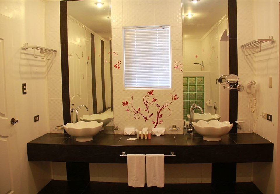 bathroom mirror sink property plumbing fixture home Suite