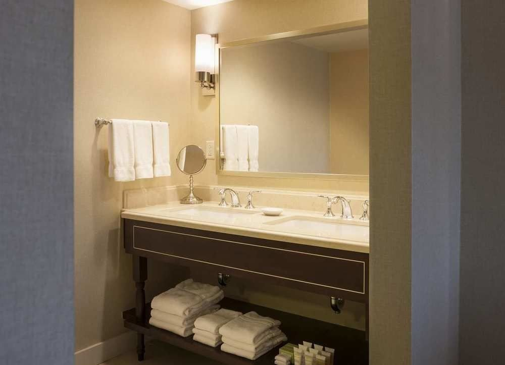 bathroom mirror property sink Suite home plumbing fixture