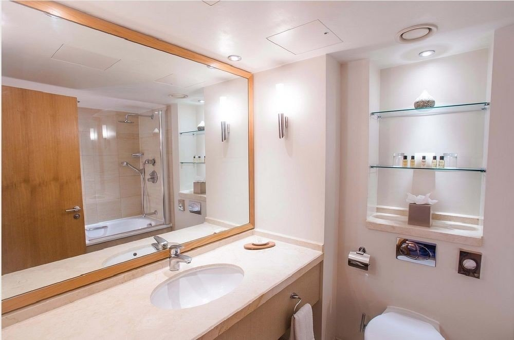 bathroom property mirror sink home toilet Suite tan