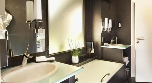 bathroom mirror sink property toilet Suite home plumbing fixture
