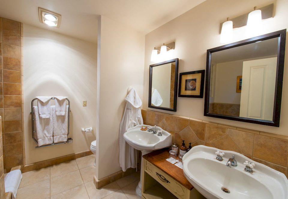 bathroom sink property Suite home toilet tile tan