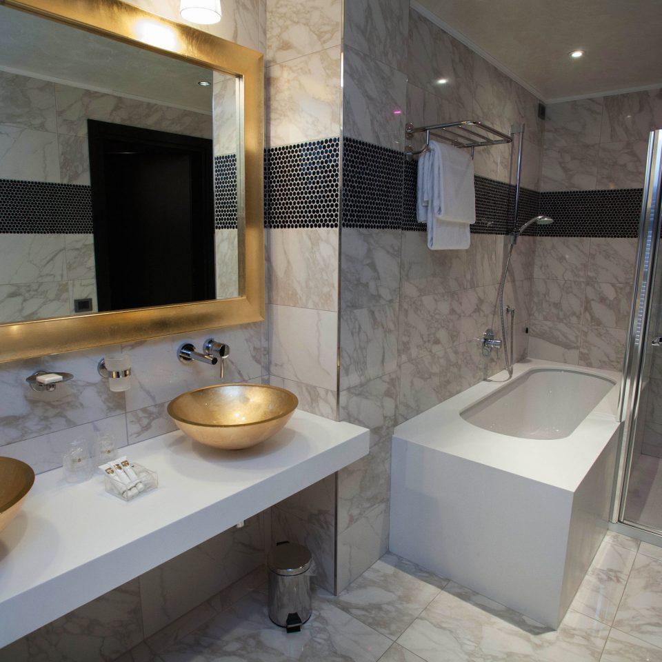 bathroom property sink swimming pool plumbing fixture jacuzzi Suite tiled