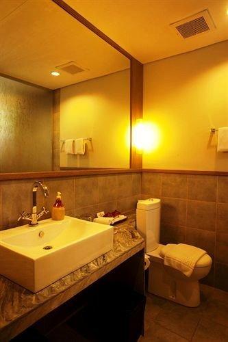bathroom sink mirror property Suite lighting swimming pool tan