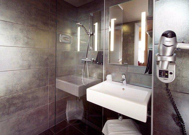 bathroom sink mirror property plumbing fixture Suite toilet public toilet tiled tile