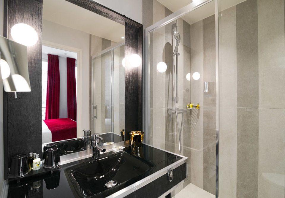 bathroom mirror property sink Suite toilet plumbing fixture