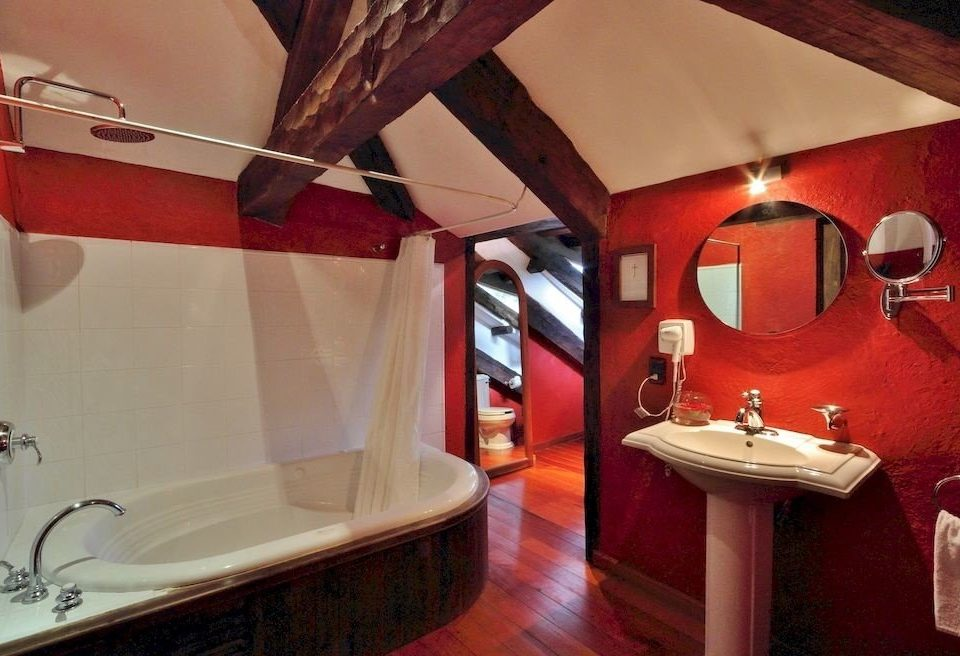 bathroom red property mirror sink restaurant Suite toilet tub tiled