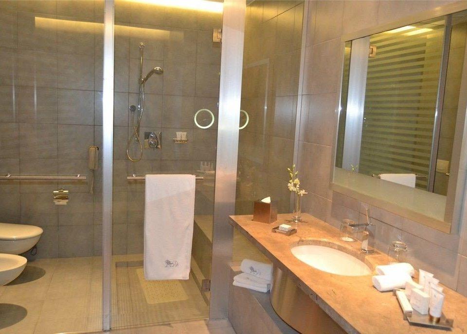 bathroom sink property toilet Suite plumbing fixture tan
