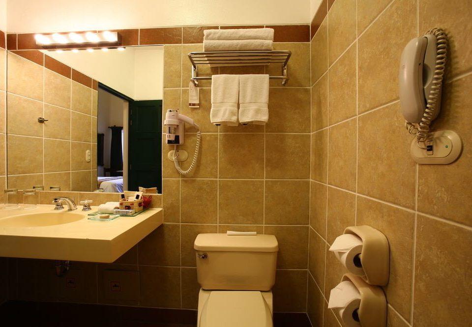 bathroom property sink plumbing fixture Suite toilet tile tiled