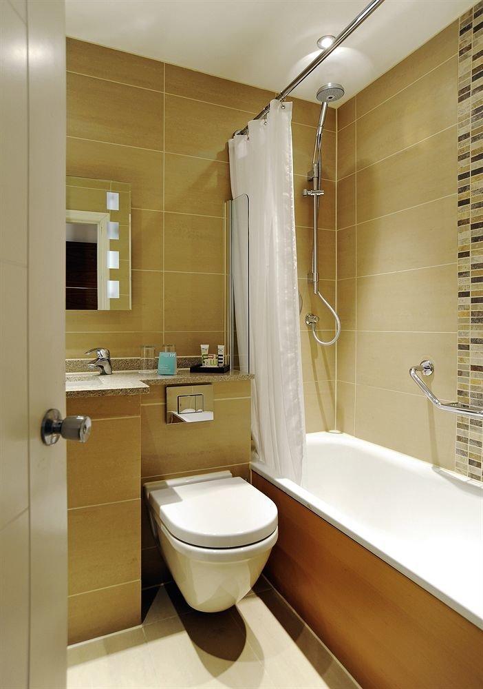 bathroom property sink plumbing fixture toilet Suite tile tiled
