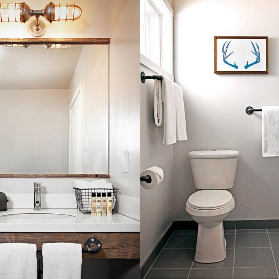 white bathroom toilet property sink plumbing fixture Suite