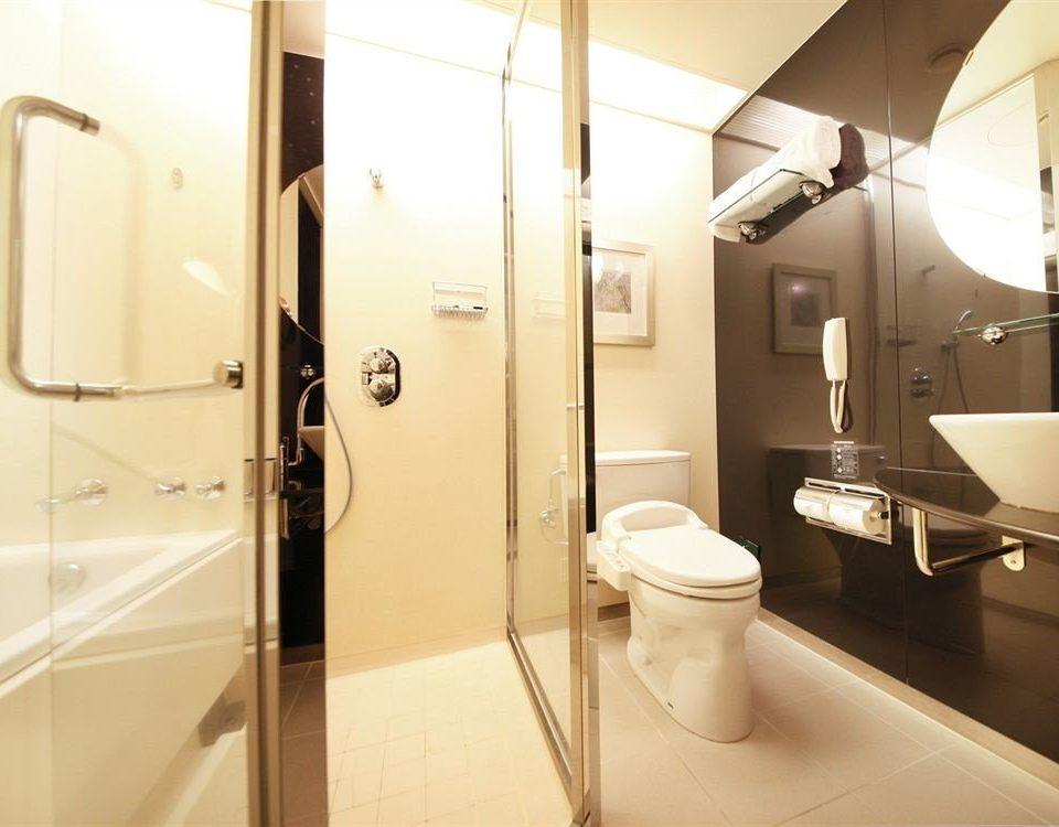 bathroom property toilet plumbing fixture Suite public toilet