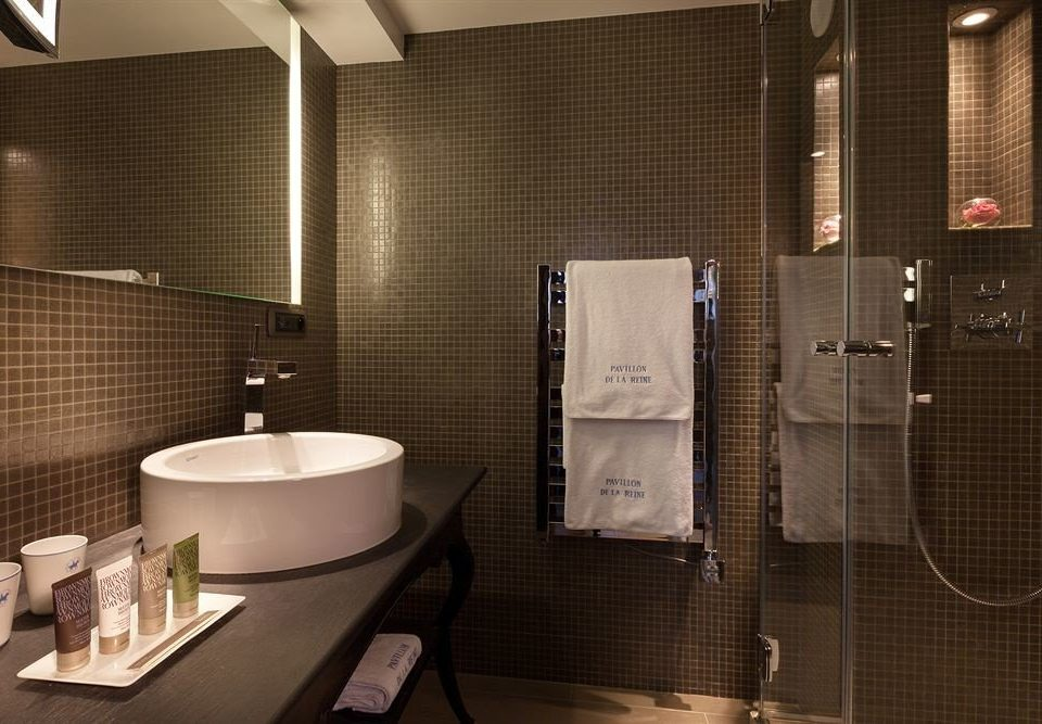 bathroom sink plumbing fixture towel Suite public toilet tiled tile rack