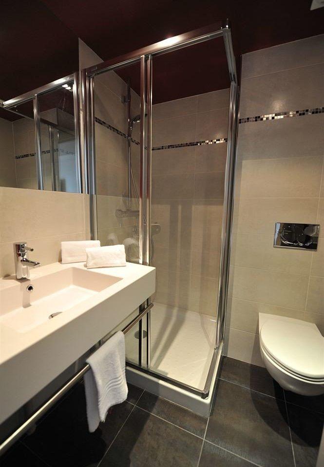 bathroom sink plumbing fixture toilet Suite stall tiled