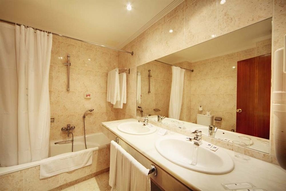 bathroom sink property toilet Suite tan tile