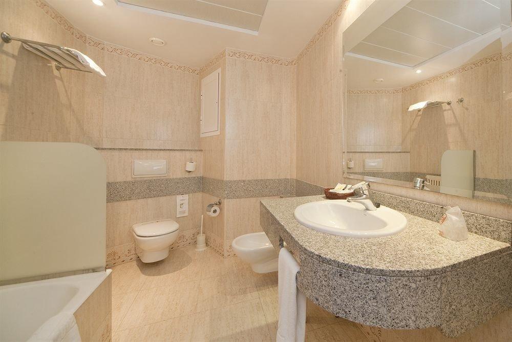 bathroom sink property Suite toilet tile tan