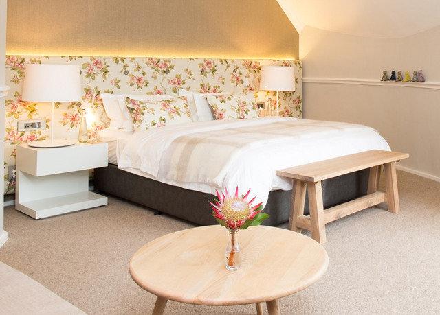 property Suite living room bed sheet cottage lamp