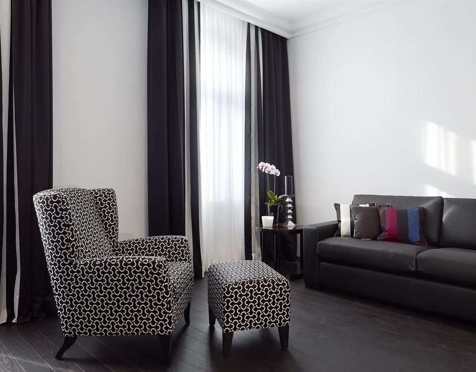 sofa chair property living room black Suite leather