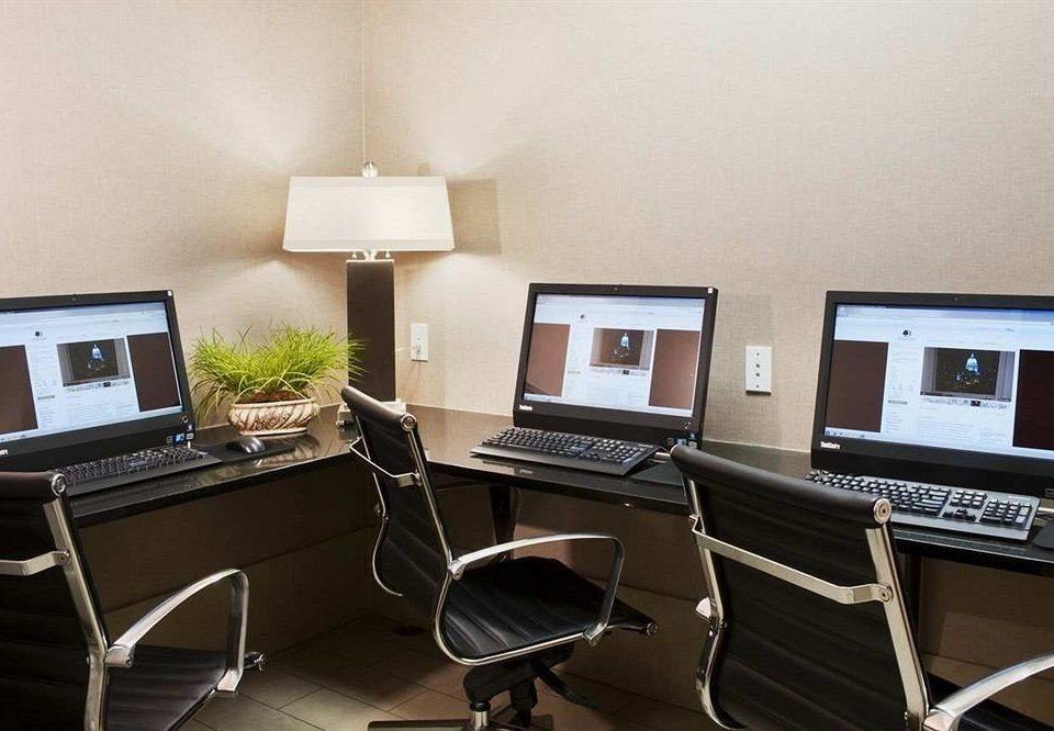 computer laptop chair desk property building living room office home condominium cottage Suite