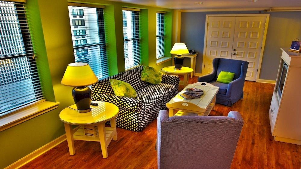 yellow property building living room Suite home condominium cottage office