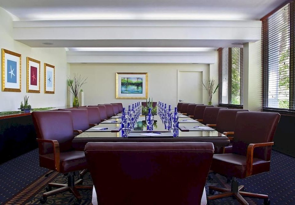 chair property conference hall recreation room living room convention center function hall Suite condominium