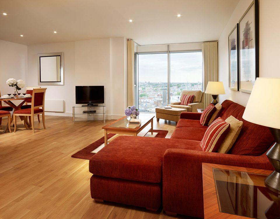 sofa chair property living room hardwood Suite home wood flooring cottage nice condominium hard