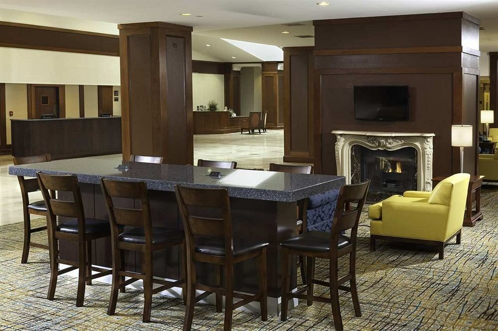 chair property home Suite living room condominium dining table
