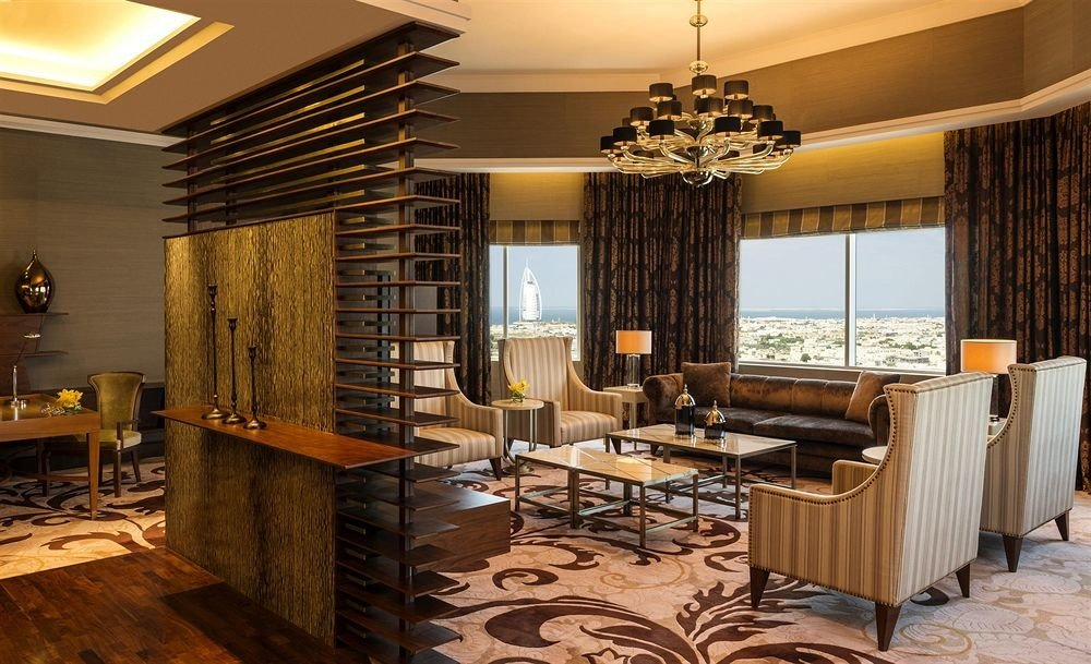 chair property living room condominium hardwood Suite home