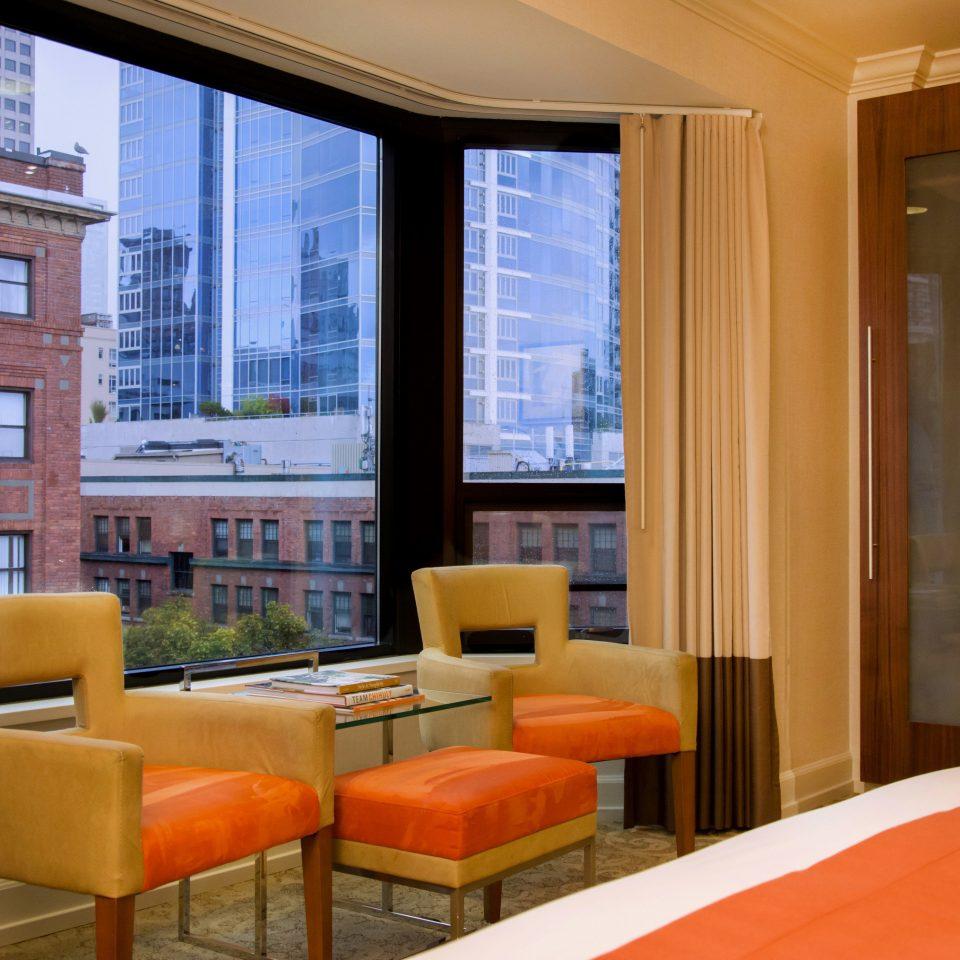 chair property condominium Suite orange home living room