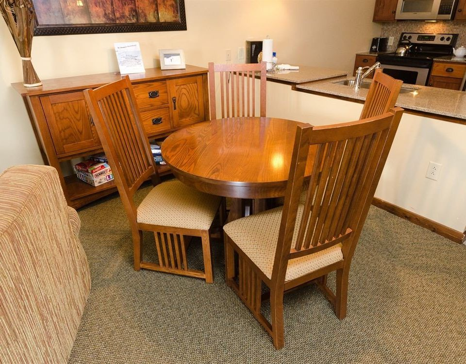 chair property home hardwood Suite cottage living room wood flooring flooring dining table