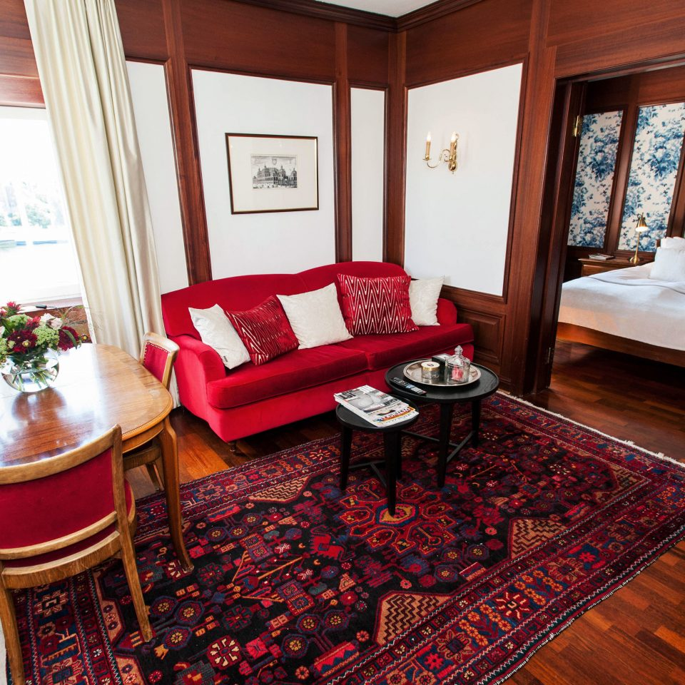 chair property red Suite home cottage hardwood living room rug mansion