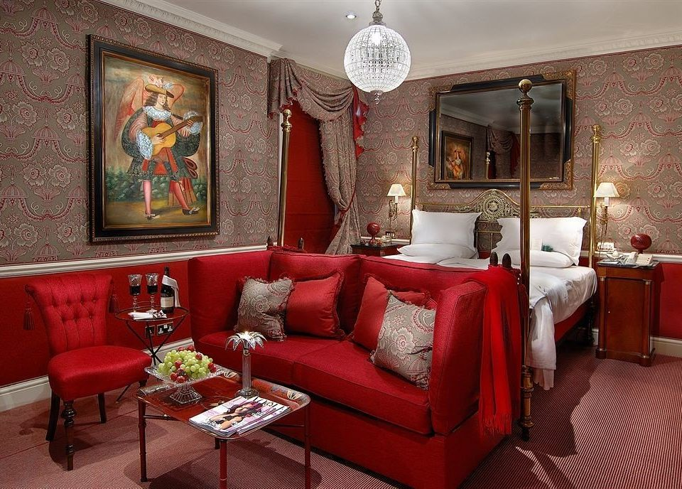 red living room chair property Suite home cottage mansion