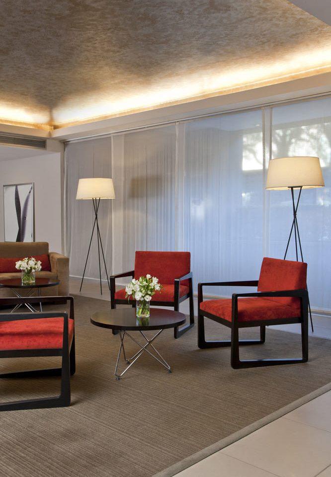chair property living room house hardwood home flooring lighting Suite wood flooring loft lamp